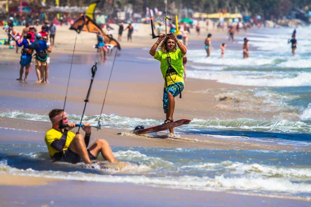2 kitesurfers preparing to go out on the water in Mui Ne