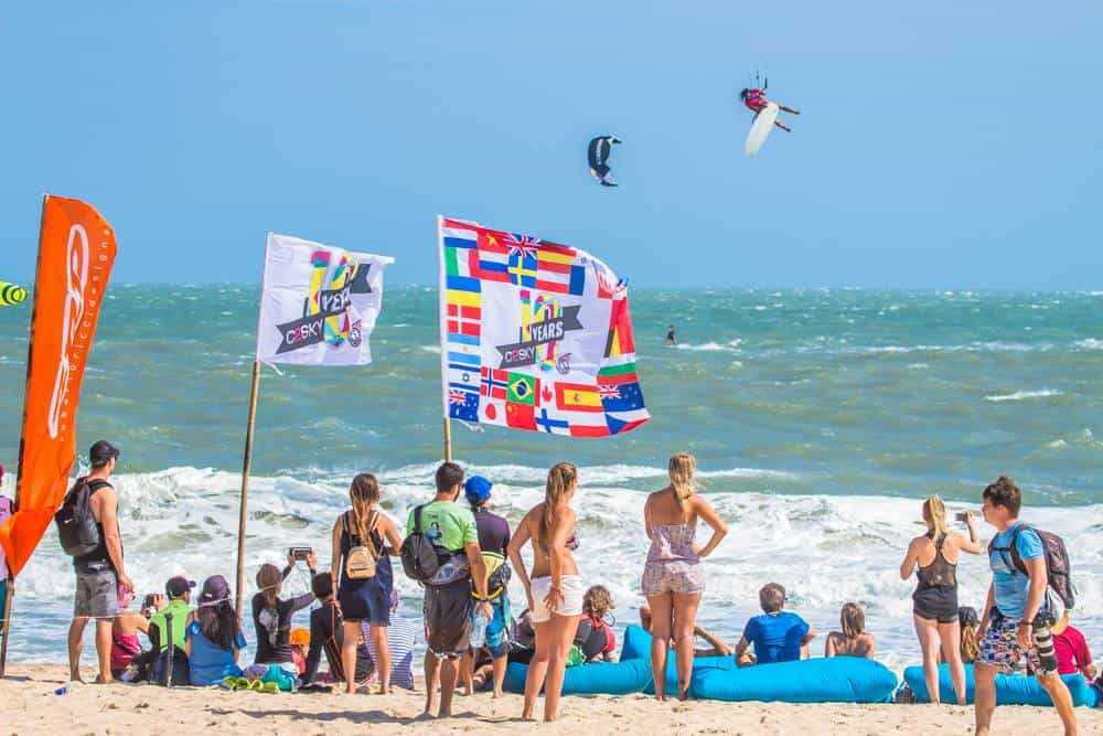 Crowd watches big air tricks on the Mui Ne kitesurfing beach