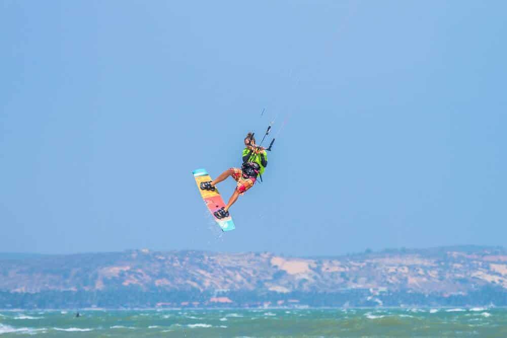 Kitesurfing doing big air tricks on Mui Ne kitesurfing beach