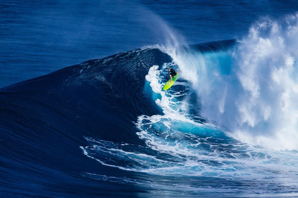 Surfer riding huge wave Jaws, in the USA