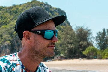 Man on beach wearing quality sunglasses with polarized Carl Zeiss lenses
