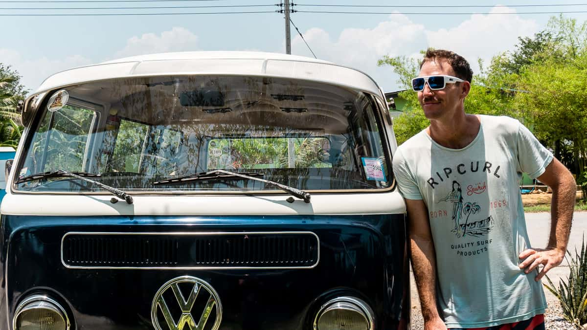 Man wearing quality sunglasses with Zeiss lenses (polarized) standing next to VW van