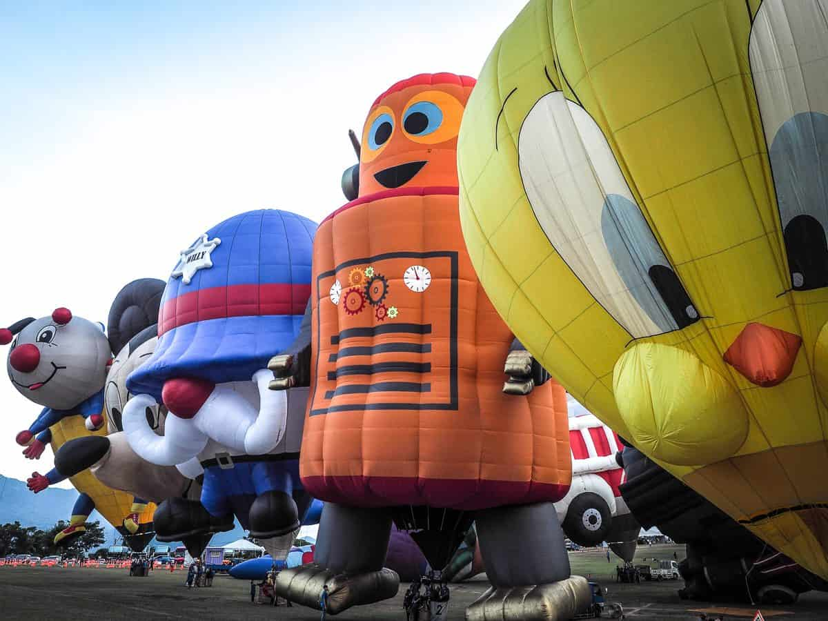 hot air balloons shaped like looney tunes characters