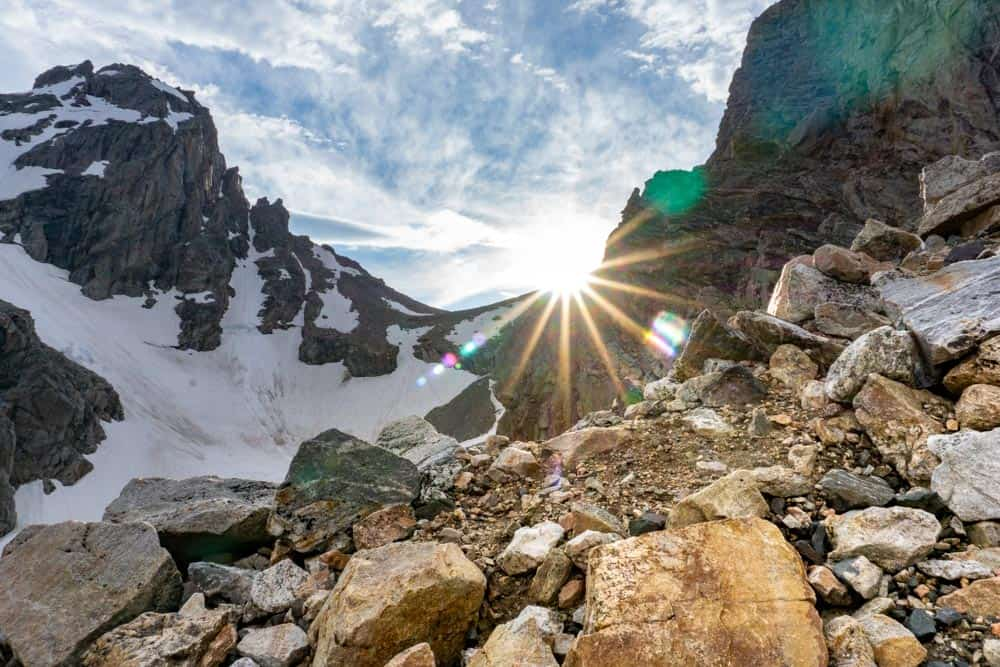 sunlight streaming through the grand teton peaks