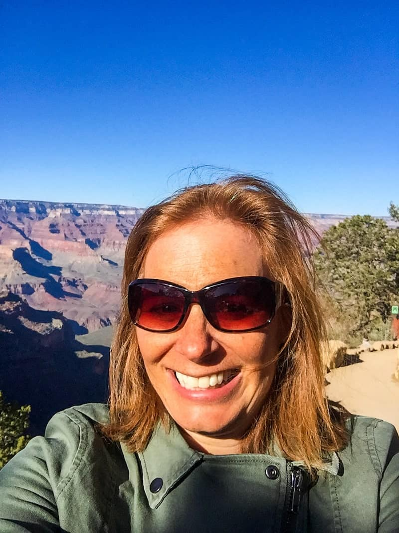 Headshot of Sarah Maurer of MissAdventurePants.com smiling on her rim to rim hike of the grand canyon