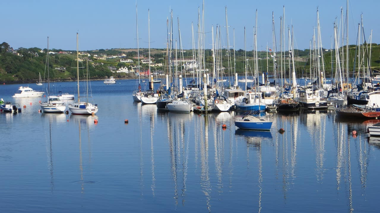 sailing boats floating on the blue water of kinsale harbour, west cork