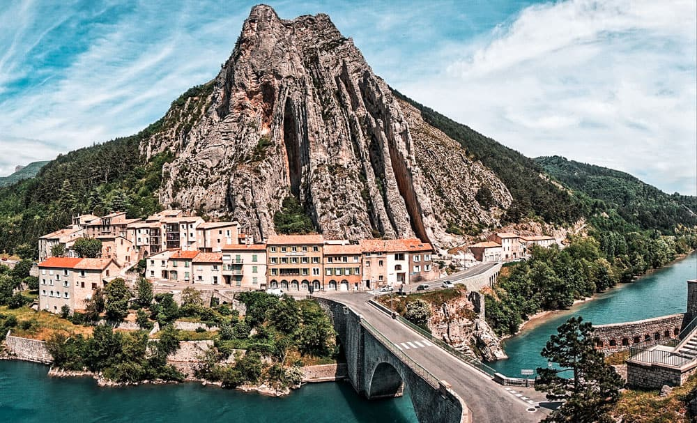 Town of Sisteron nestled beneath a big rocky outcropping