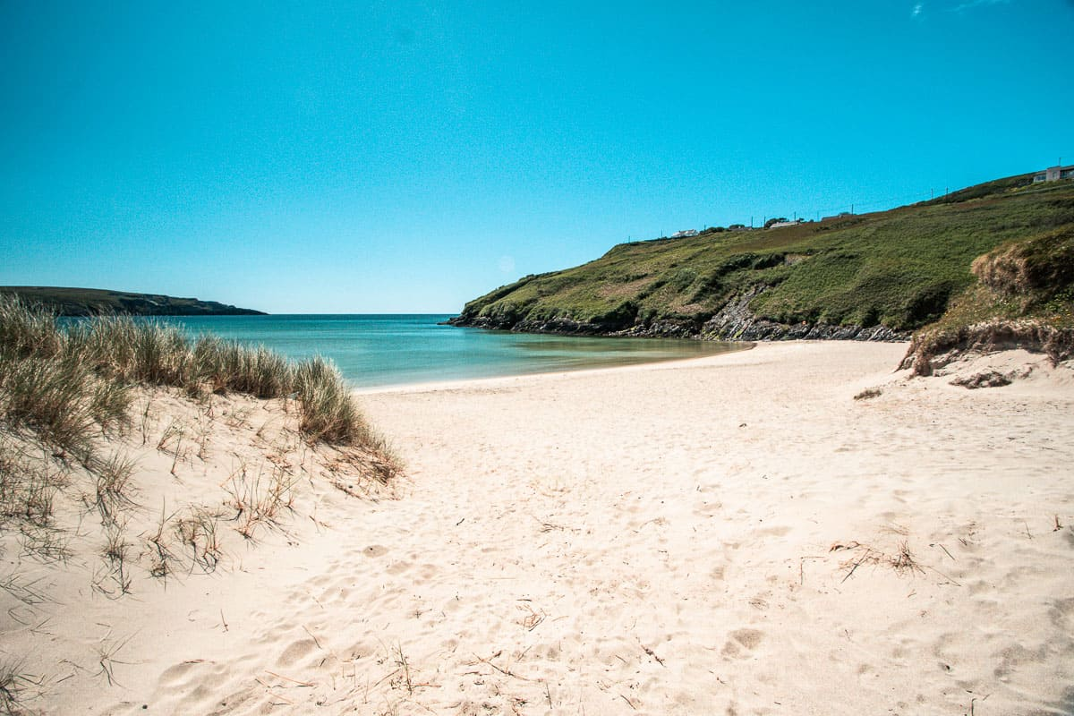 sandy beach on a bright blue-sky day in Barley Cove, West Cork (Ireland)