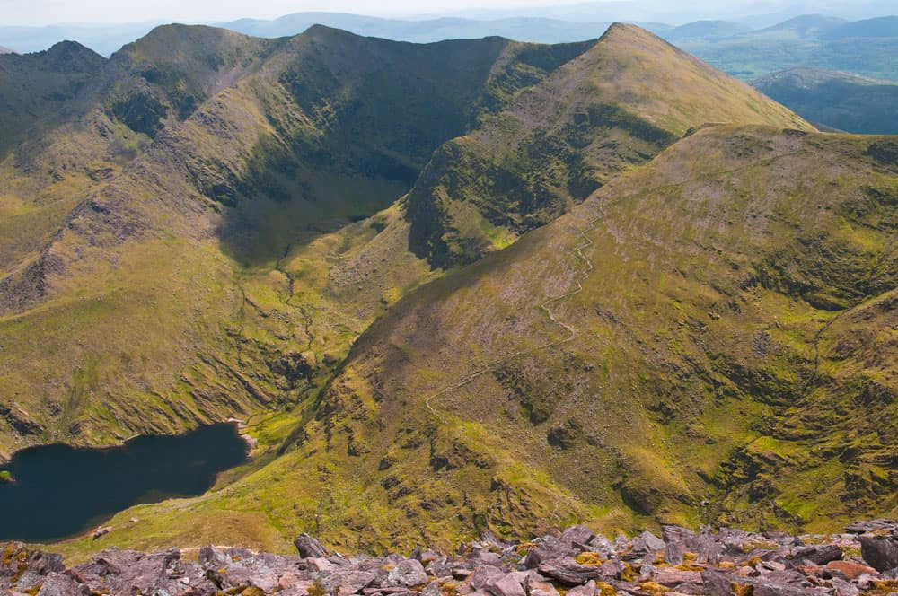 grass covered mountains of carrauntoohil, the tallest mountain you can hike in ireland