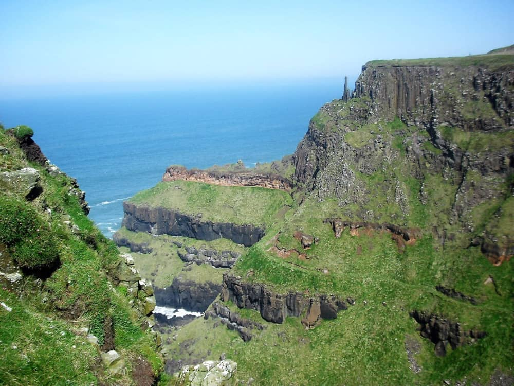 seaside cliffs facing out over the blue water of the atlantic at the causeway coast, county antrim, ireland