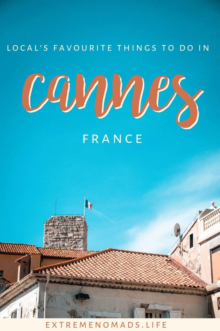 "pinterest image of a bright blue sky with a couple of terracotta coloured rooftops peaking over the bottom. the image has a caption that reads ""local's favourite things to do in cannes france"""