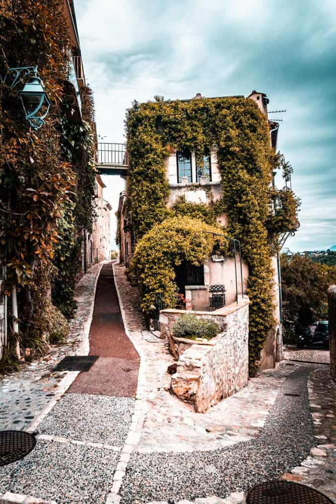 An ivy covered building on the corner of two small laneways in Saint Paul de Vence.