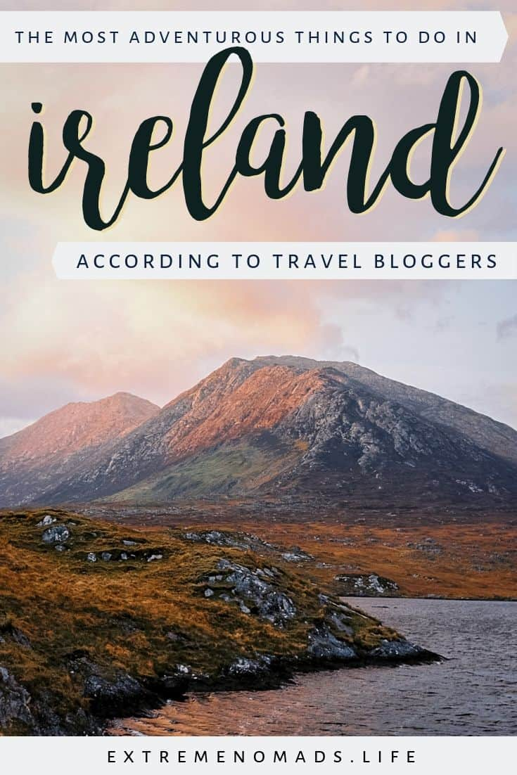 pinterest image with a picture of a pink sky over the connemara mountains and a caption that reads: the most adventurous things to do in ireland according to travel bloggers