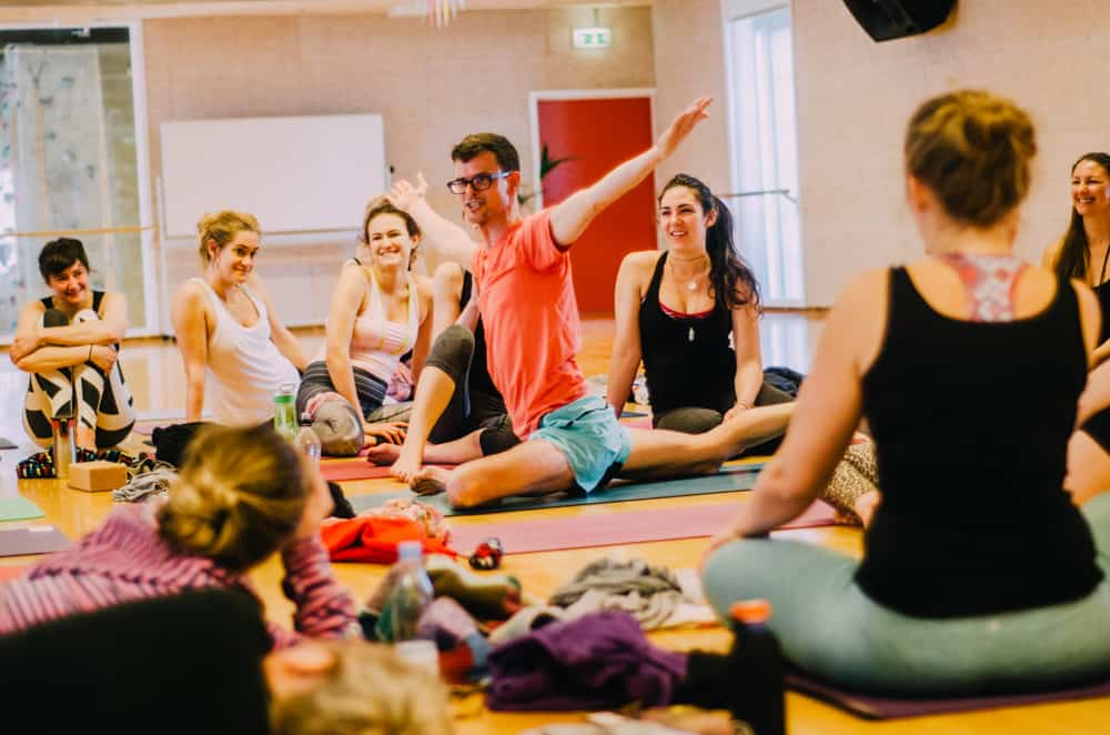 Stephen teaching a yoga class at Yogi Nomads yoga festival in Europe.
