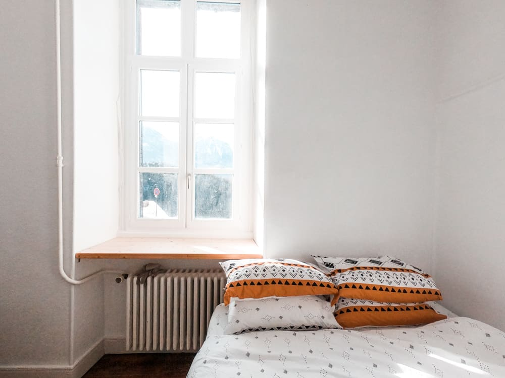 the spacious white bedroom of cloud citadel coliving space