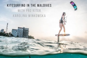 cover photo with a picture of karolina foil kiting in the maldives. she's flying a purple kite and riding a hydrofoil board. the shot is half underwater so we can see the clear blue water that's typical of the maldives.
