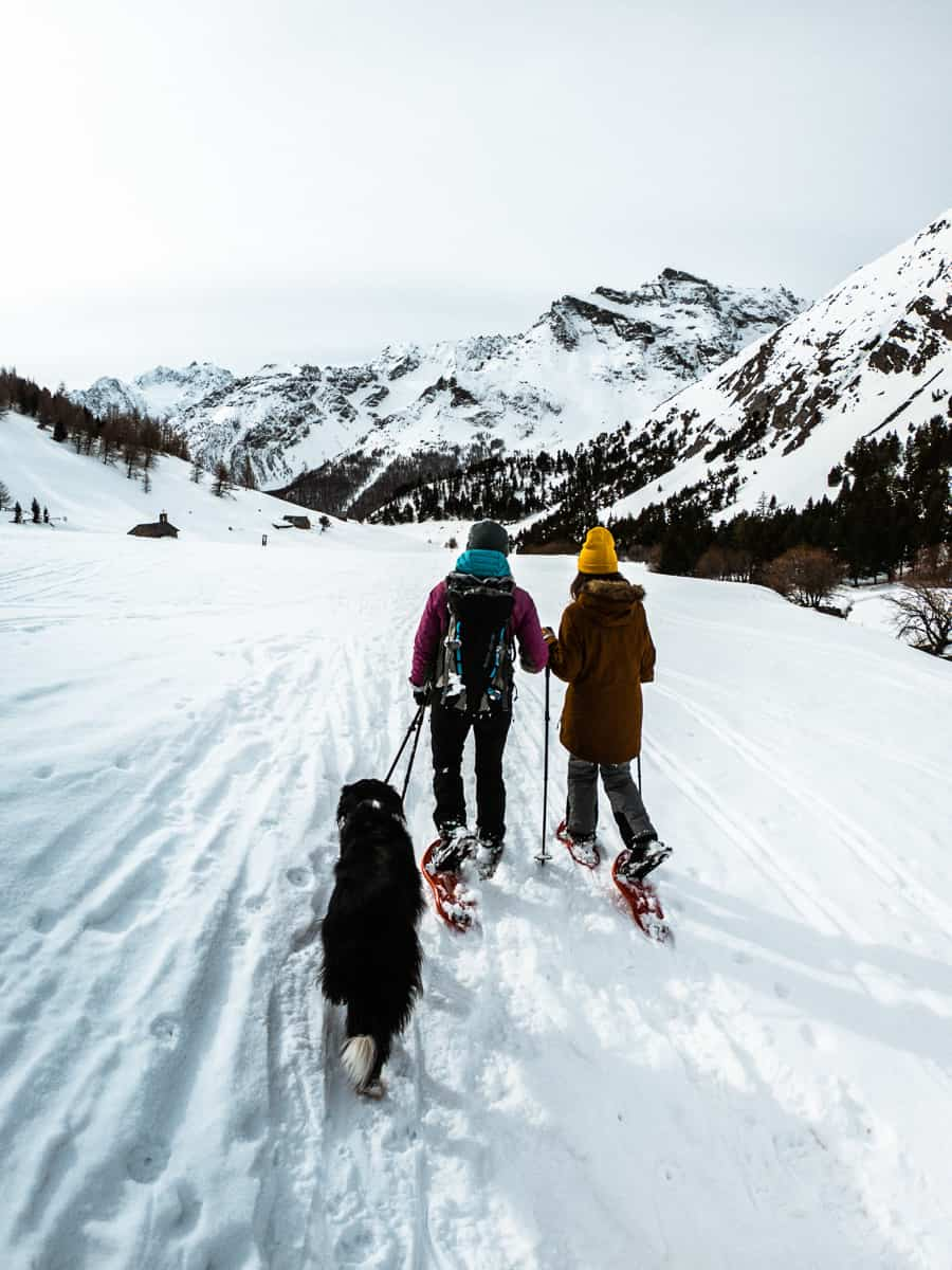 rachel, grace,and gekko the dog snowshoeing back towards the car parked just outside le monetier-les-bains
