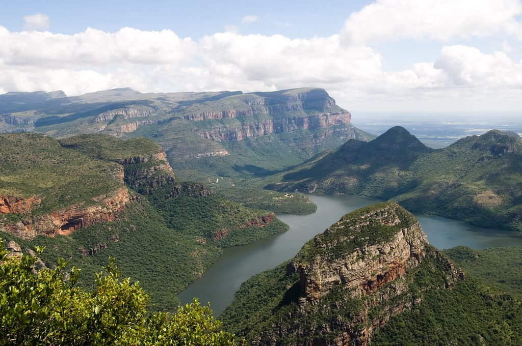 the blyde river canyon in africa on a hazy blue sky day.